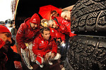 Sébastien Loeb and Daniel Elena and Citroën Total Abu Dhabi World Rally Team look at tires