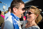 Race winner Scott Pruett celebrates with his wife