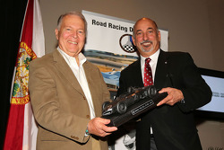 Peter Brock receives the Phil Hill award from Bobby Rahal