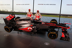 Jenson Button, McLaren and team mate Sergio Perez, McLaren with the new McLaren MP4-28