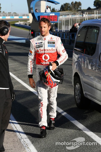 Jenson Button, McLaren returns to the pits after stopping on the circuit