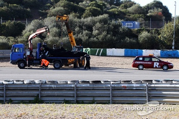 The Mercedes AMG F1 W04 of Lewis Hamilton recovered back to the pits on the back of a truck