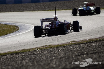 Jenson Button, McLaren MP4-28 leads Felipe Massa, Ferrari F138