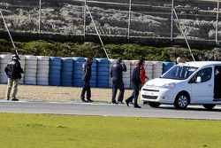 Scuderia Toro Rosso inspect the hole at turns 9 and 10
