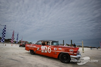 Vintage race cars parade on the beach