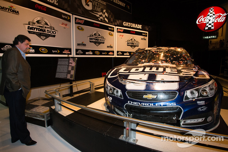 NASCAR President Mike Helton has a look at the 2013 Daytona 500 winning car of Jimmie Johnson, Hendrick Motorsports Chevrolet