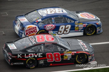 Travis Kvapil, BK Racing Toyota and Michael McDowell, Phil Parsons Racing Ford battle on pit road