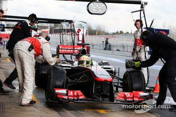 Sergio Perez, McLaren MP4-28 in the pits