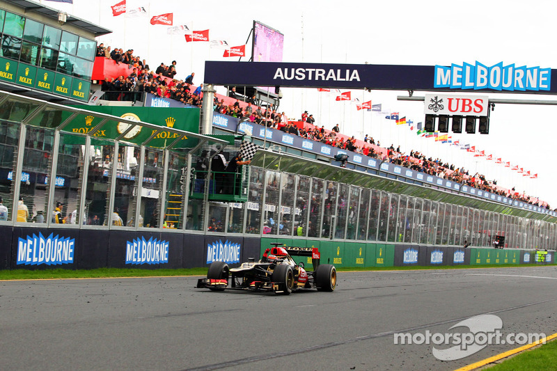 Race winner Kimi Raikkonen, Lotus F1 E21 celebrates at the end of the race