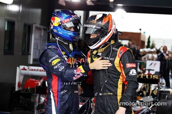 Race winner Kimi Raikkonen, Lotus F1 Team celebrates with Sebastian Vettel, Red Bull Racing in parc ferme