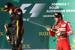 (L to R): Race winner Kimi Raikkonen, Lotus F1 Team celebrates with Fernando Alonso, Ferrari on the podium