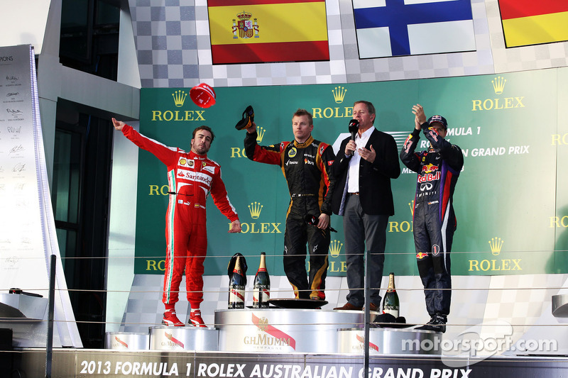 The podium, Ferrari, second; Kimi Raikkonen, Lotus F1 Team, race winner; Sebastian Vettel, Red Bull Racing, third