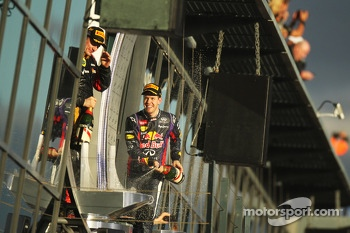 Sebastian Vettel, Red Bull Racing and race winner celebrate on the podium