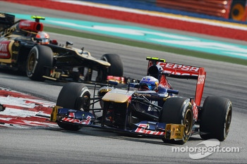 Jean-Eric Vergne, Scuderia Toro Rosso STR8 leads Romain Grosjean, Lotus F1 E21
