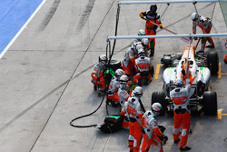 Adrian Sutil, Sahara Force India VJM06 makes a long pit stop with a front wheel problem