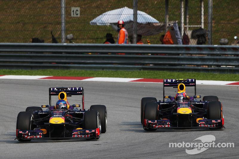 Sebastian Vettel, Red Bull Racing RB9 and team mate Mark Webber, Red Bull Racing RB9 battle for the lead of the race