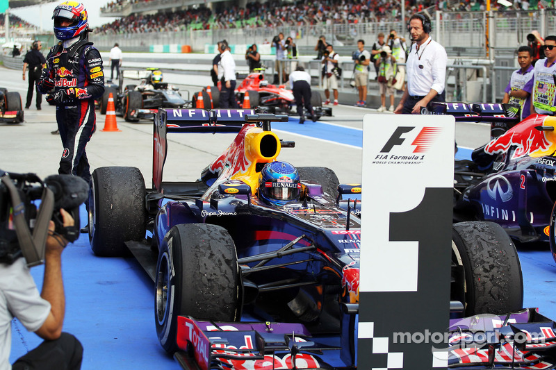 Race winner Sebastian Vettel, Red Bull Racing RB9 in parc ferme as team mate Mark Webber, Red Bull Racing walks past