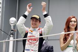 Podium: race winner Stefano Coletti celebrates