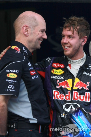 Race winner Sebastian Vettel, Red Bull Racing RB9 celebrates in parc ferme with Adrian Newey