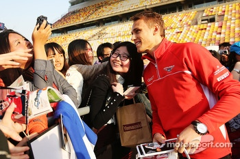 Max Chilton, Marussia F1 Team poses for photos with the fans
