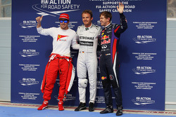 The top three qualifiers in Parc Ferme: Fernando Alonso, Ferrari, third; Nico Rosberg, Mercedes AMG F1, pole position; Sebastian Vettel, Red Bull Racing, second