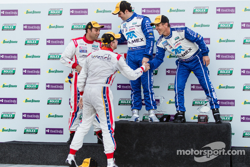 Overall podium: winners Scott Pruett and Memo Rojas, second place Ryan Dalziel, Alex Popow