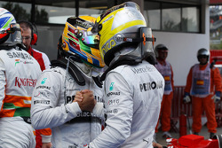 (L to R): Lewis Hamilton, Mercedes AMG F1 with pole sitter Nico Rosberg, Mercedes AMG F1 in parc ferme