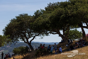 Fans watching the race from the shade
