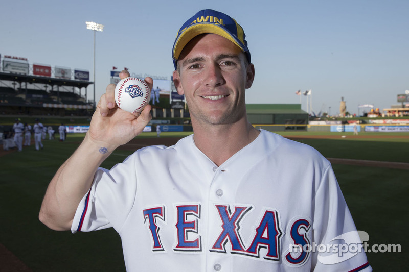 Lee Holdsworth throws the first pitch at a Texas Rangers MLB game