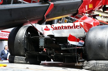 The damaged Ferrari F138 of Felipe Massa, Ferrari is recovered back to the pits on the back of a truck