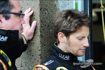 Romain Grosjean, Lotus F1 Team with Eric Boullier, Lotus F1 Team Principal