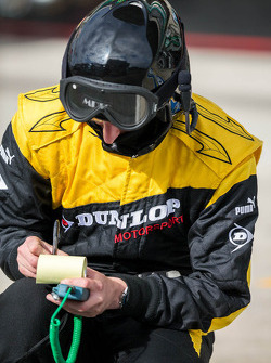 Dunlop tire engineer monitoring track temperaturs