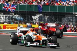 Adrian Sutil, Sahara Force India VJM06 leads Felipe Massa, Ferrari F138