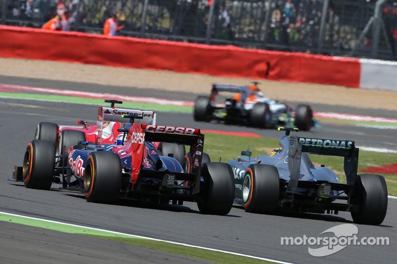 Daniel Ricciardo, Scuderia Toro Rosso and Lewis Hamilton, Mercedes Grand Prix