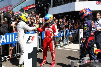 Race winner Nico Rosberg Mercedes AMG F1 celebrates with Fernando Alonso Ferrari and Mark Webber Red Bull Racing