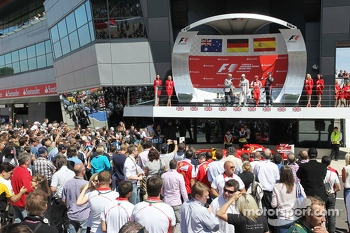 The podium Mark Webber Red Bull Racing, second; Nico Rosberg Mercedes AMG F1, race winner; Fernando Alonso Ferrari, third