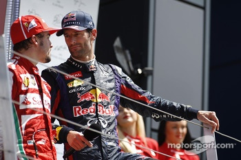 Fernando Alonso Ferrari talks with Mark Webber Red Bull Racing on the podium