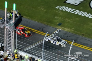 Jimmie Johnson, Hendrick Motorsports Chevrolet takes the checkered flag in front of Tony Stewart, Stewart-Haas Racing Chevrolet