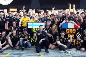 Eric Boullier, Lotus F1 Team Principal celebrates with second placed Kimi Raikkonen, Lotus F1 Team, third placed Romain Grosjean, Lotus F1 Team, and the rest of the team