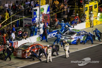Pit stop for Casey Mears, Germain Racing Ford and David Reutimann, BK Racing Toyota