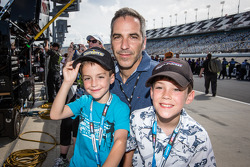 Grand Am Rolex Series driver Joao Barbosa watches qualifying with his kids