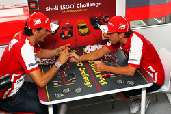 (L to R): Pedro De La Rosa, Ferrari Development Driver with Fernando Alonso, Ferrari play the Ferrari Shell Lego Challenge