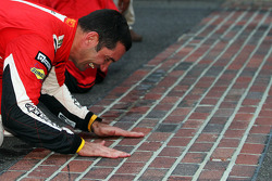 GT winner Max Papis kisses the yard of bricks