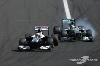 Pastor Maldonado, Williams F1 Team and Nico Rosberg, Mercedes GP