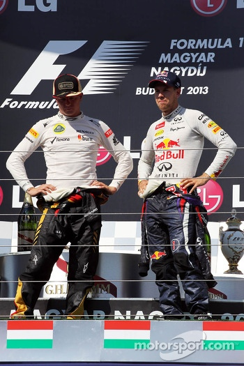 (L to R): Kimi Raikkonen, Lotus F1 Team and Sebastian Vettel, Red Bull Racing on the podium