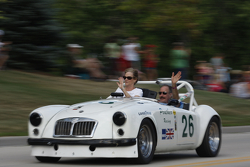 Race cars parade into Elkhart Lake for the Friday concours. #26 1962 MG A: Kent Prather