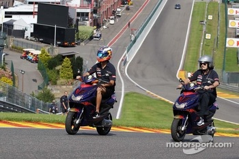Daniel Ricciardo, Scuderia Toro Rosso rides the circuit on a moped.