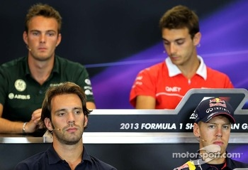 Jean-Eric Vergne, Scuderia Toro Rosso  and Sebastian Vettel, Red Bull Racing at the press conference.