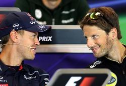 Sebastian Vettel, Red Bull Racing and Romain Grosjean, Lotus F1 Team at the press conference
