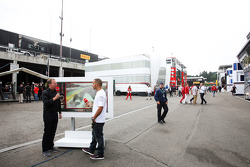 Lewis Hamilton, Mercedes AMG F1 describes his pole lap with Martin Brundle, Sky Sports Commentator in the paddock